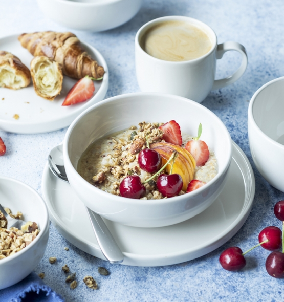 Breakfast porridge with fruit and coffee