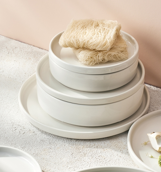 Stacking plates and bowls with noodles